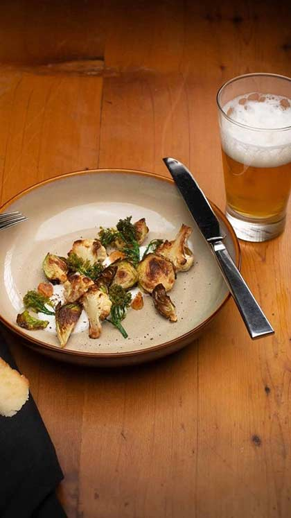 Beer with Roasted Brussels and Cauliflower at the CIA's Savor restaurant in the Pearl District of San Antonio, Texas.