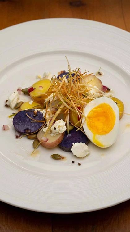 Fingerling Potatoes and Soft Egg Salad at the CIA's Savor restaurant in the Pearl District of San Antonio, Texas.